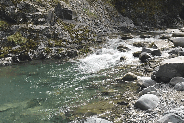 fast-river-over-rocks-in-gorge
